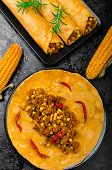stock photo of mixture  - Tomato tortilla with spicy meat mixture jalapeno thyme and corn - JPG