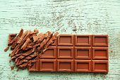 pic of milk products  - Milk chocolate bar on color wooden background - JPG