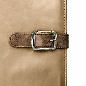pic of leather-bound  - notebook closeup with buckle in the form of a leather strap - JPG