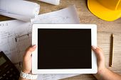 foto of architecture  - tablet architecture equipment with work tool on wooden desk  - JPG