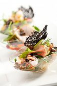 foto of buffet lunch  - Buffet Seafood Salad on White Dish - JPG