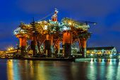 stock photo of big-rig  - Oil Rig in the shipyard for maintenance at night - JPG