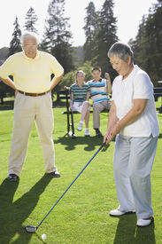 stock photo of foursome  - Senior Asian woman playing golf - JPG