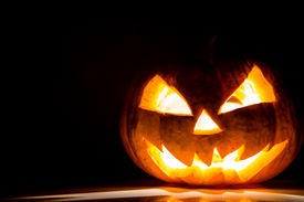 stock photo of scary face  - Halloween scary face pumpkin on black background - JPG