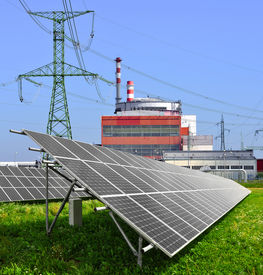 foto of reactor  - Solar energy panels before a reactor of nuclear power plant  - JPG