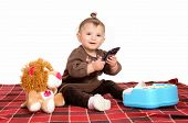 pic of toy phone  - A little baby girl sitting on a blanket on the floor with her toy