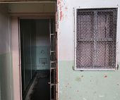 stock photo of lockups  - A row of jail cells in an old prison - JPG