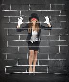 stock photo of mockingbird  - Businesswoman plays to mime imagining a wall - JPG