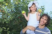 pic of daddy  - A girl and her daddy with apple background - JPG
