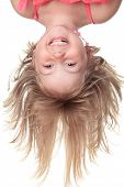 picture of upside  - Little beautiful girl in pink clothes upside down isolated on white - JPG