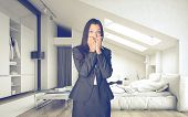 pic of oblique  - Shocked Office Woman in Business Suit inside an Architectural Room Looking at the Camera - JPG