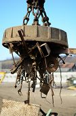 foto of scrap-iron  - electro magnetic pull  scrap in recycling center - JPG