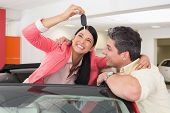 stock photo of showrooms  - Smiling couple buying a new car at new car showroom - JPG