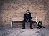 picture of mans-best-friend  - Young man sitting on a bench with your best four - JPG