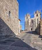 foto of dom  - The Medieval Tower on the left and the Porto Cathedral seen through the Dom Pedro Pitoes Street - JPG