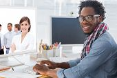 stock photo of arms race  - Confident manager in front of her team with folded arms against portrait on a creative business worker on computer - JPG