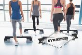 stock photo of step aerobics  - The word gym heroes and aerobics class in session against badge - JPG