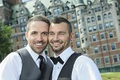 stock photo of gay wedding  - Portrait of a loving gay male couple on their wedding day - JPG