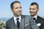 pic of gay wedding  - Portrait of a loving gay male couple on their wedding day.