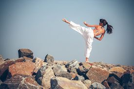 stock photo of karate-do  - Young girl training karate - JPG