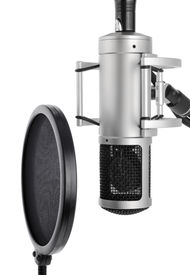 image of recording studio  - Vocal recording setup containing a professional microphone and pop filter on white background - JPG