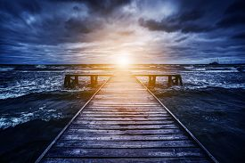 stock photo of jetties  - Old wooden jetty during storm on the ocean - JPG