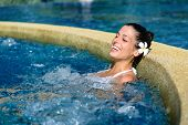 picture of relaxing  - Beautiful happy woman enjoying relax in spa at resort pool - JPG