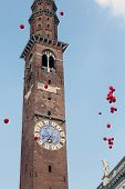 stock photo of freedom tower  - high clock tower with colorful balloons during the Festival in VICENZA in Italy - JPG