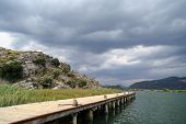 image of dalyan  - Side view of wooden pier in the river between Koycegiz Lake and Iztuzu Beach in Dalyan - JPG
