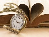 picture of vintage antique book  - Vintage antique pocket watch and heart of the book - JPG