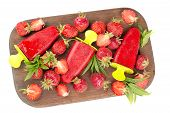 picture of strawberry  - strawberries strawberry ice cream on a wooden board strawberries scattered on the board - JPG