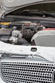 picture of muscle-car  - engine car in workshop for assistance in troubleshooting - JPG