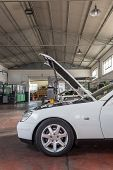picture of muscle-car  - car with the hood open in repair workshop - JPG