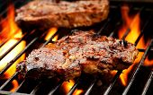 picture of pork chop  - Close up of pork chops on the grill - JPG
