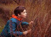 stock photo of preteens  - preteen handsome boy play hide and seek game