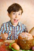 pic of preteens  - preteen handsome boy decorate easter egg and cake