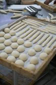 foto of home-made bread  - Freshly made bread dough on a tray showing rolls and frenchies ready to be baked - JPG