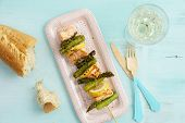 stock photo of baguette  - Grilled green asparagus skewers with salmon baguette and lemons - JPG