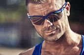 foto of hustle  - Portrait of a handsome young man in sunglasses - JPG