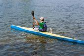 foto of kayak  - This teen takes part in competitions in rowing kayaking - JPG