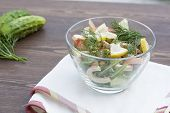 pic of squid  - Salad of cooked squid, fresh vegetables and herbs in glass bowl ** Note: Visible grain at 100%, best at smaller sizes - JPG