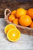 foto of valencia-orange  - still life of oranges on wicker and wood background - JPG