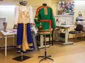 stock photo of national costume  - Company making Russian national folk costumes accessories - JPG