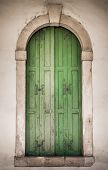 pic of pilaster  - Ancient stone window with green wooden balcony - JPG