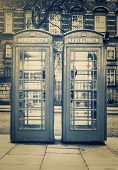 stock photo of phone-booth  - Vintage monochrome image of the famous phone booths in London - JPG