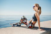 foto of bottle water  - Young fitness blonde woman hold bottle water after fit at beach - JPG