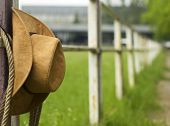 picture of lasso  - Cowboy hat and lasso on fence American Horse ranch background - JPG
