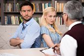 stock photo of psychologist  - Young couple talking with psychologist - JPG