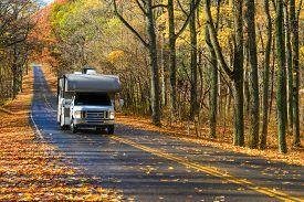 stock photo of twisty  - Asphalt road with autumn foliage - Shenandoah National Park, Virginia United States  - JPG