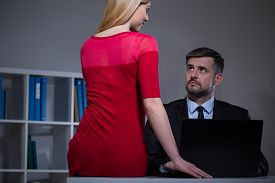 picture of seduce  - Attractive secretary seducing her boss in office - JPG